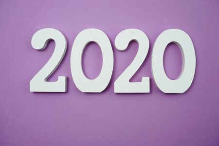 2020 happy new year with space copy on purple background