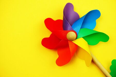 colorful pinwheel with space copy isolated on yellow background