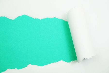Paper torn with space copy on green mint background
