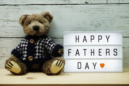 Happy Fathers Day word on light box with teddy bear Stock fotó