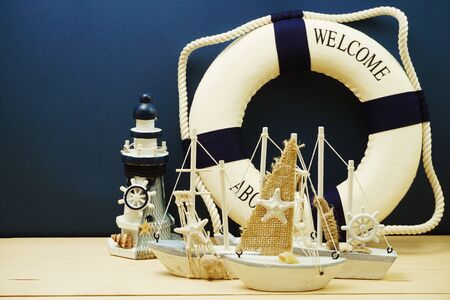 Nautical background with Sailboat Model with summer sale on blue background Фото со стока