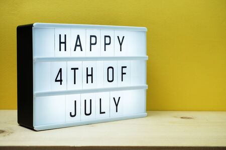 Happy 4th of July light box with space copy on yellow background