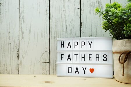 Happy Fathers Day word on light box on wooden background