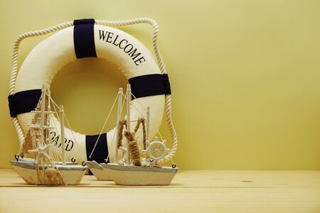 Nautical background with Sailboat Model with summer sale on yellow background Фото со стока