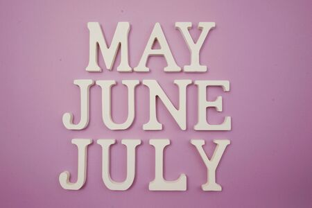 Month of May June and July alphabet letter on purple background