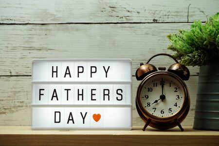 Happy Fathers Day word on light box and alarm clock