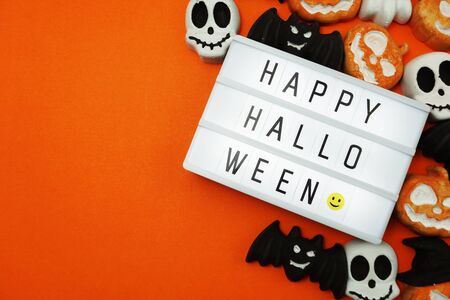 Top view Happy Halloween word in Light box flat lay