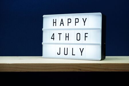 Happy 4th of July light box with space copy on blue background