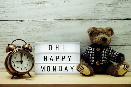 Happy Monday light box alphabet wording on wooden background