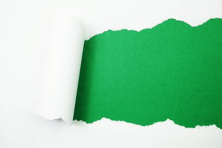 Paper torn with space copy on green background