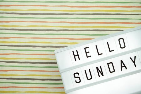Top view Happy Sunday Text in Light box flat lay with space copy background