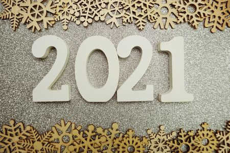 2021 happy new year with snowflake decoration on silver glitter background