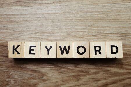 Keyword alphabet letter on wooden background