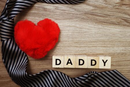 Happy Father's Day concept with DADDY alphabet letter with space copy on wooden background