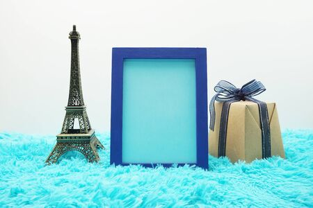 Mock-up space Photo Frame with Souvenir Eiffel Tower and gift box