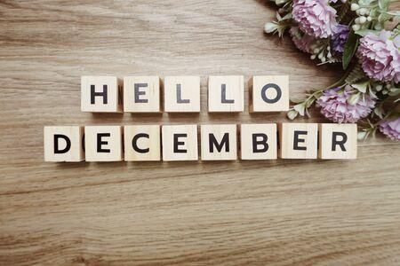 Hello December alphabet letters on wooden background Banco de Imagens