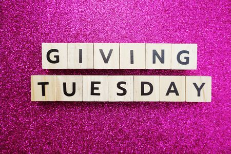 Giving Tuesday alphabet letter on Pink glitter background