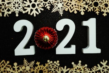 2021 with snowflake border frame Flat lay on black glitter background Stock Photo