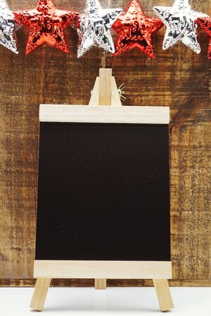 Space wooden easel black on wooden background