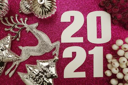 Happy New Year 2021 Decoration with Christmas ornament Flat lay on pink glitter background