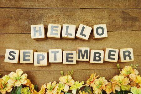 Hello September alphabet letters on wooden background