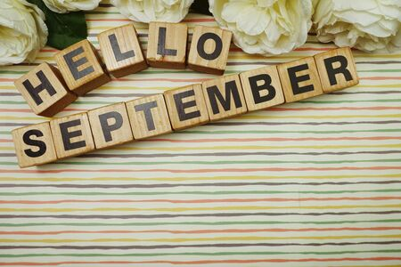Hello September alphabet letters with space copy on colorful Stripes background
