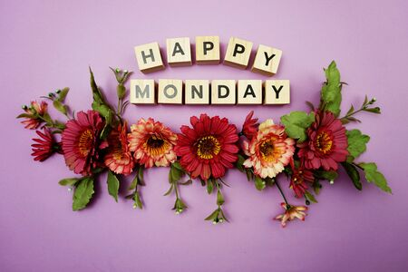 Happy Monday alphabet letters with pink flower decoration on purple background