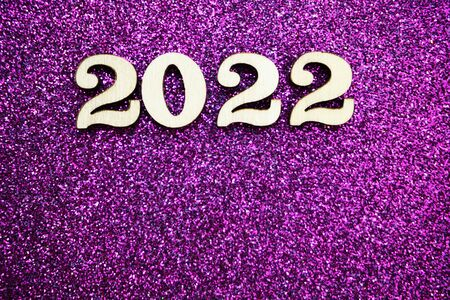 Happy New year 2022 with space copy on purple glitter background