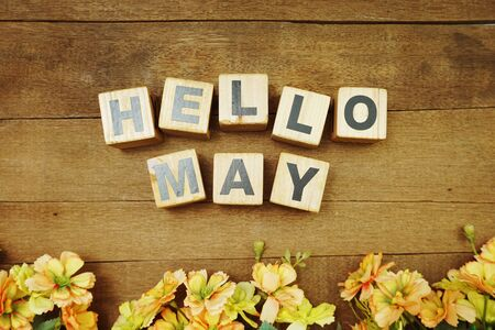 Hello May alphabet letters on wooden background Banco de Imagens