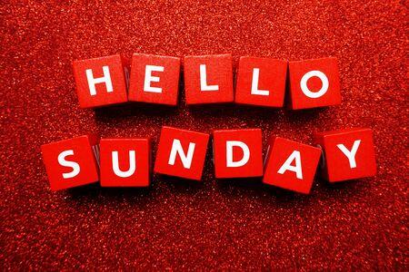 Hello Sunday alphabet letter on red glitter background