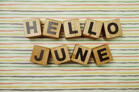 Hello June alphabet letters on colorful stripes background