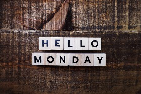 Hello Monday alphabet letters with space copy on wooden background Banco de Imagens