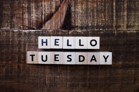 Hello Tuesday alphabet letters with space copy on wooden background