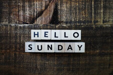 Hello Sunday alphabet letter with space copy on wooden background