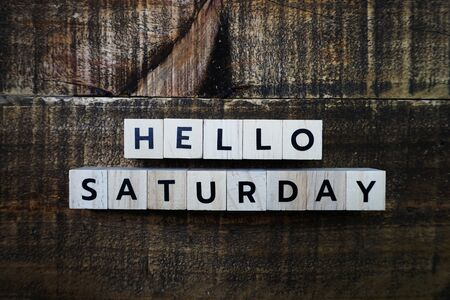 Hello Saturday alphabet letter with space copy on wooden background