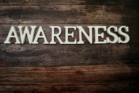 Awareness alphabet letters on wooden background