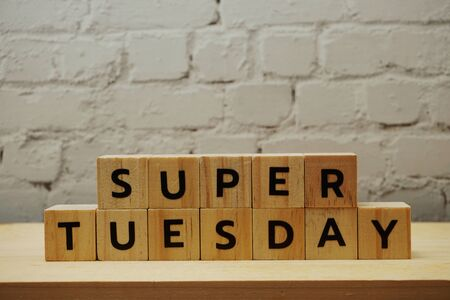 Super Tuesday alphabet letter on wooden background