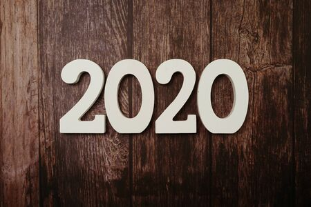 2020 Happy New Year with space copy on wooden background