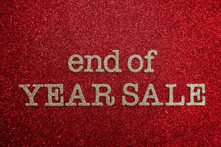 End of Year Sale alphabet letter on red glitter background