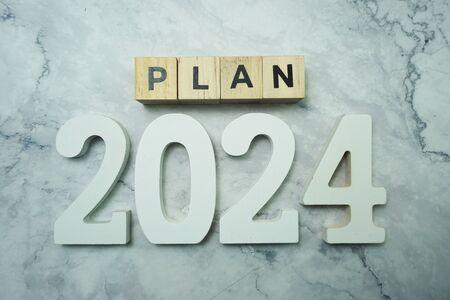 Plan 2024 alphabet letter on marble background
