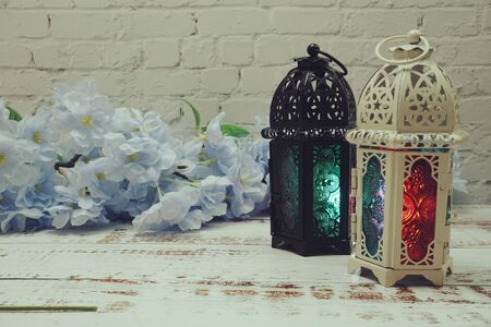 Ramadan Lantern Arabic decoration with space copy on white brick wall background Banque d'images