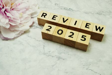 Review 2025 word alphabet letters on marble background Stock Photo