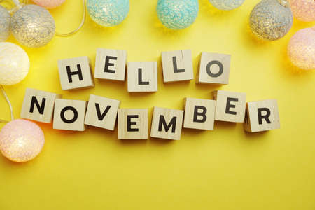 Hello November alphabet letter with LED Cotton ball Decoration on yellow background Banque d'images