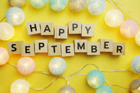 Happy September alphabet letter with LED Cotton ball Decoration on yellow background