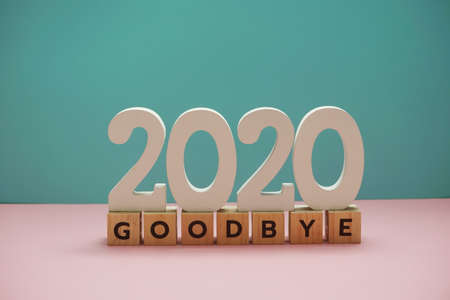 Goodbye 2020 alphabet letter on blue and pink background