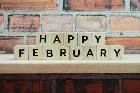 Happy February alphabet letter on shelves wooden background
