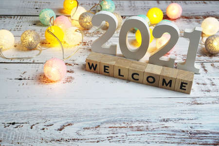 Welcome 2021 word alphabet letters on wooden background