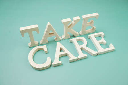 Take Care word alphabet letters on blue background