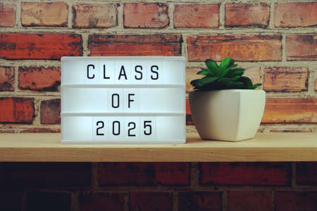 Class of 2025 alphabet letter on wooden background