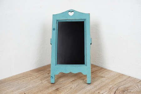 Empty Easel with Space copy background on wooden and white wall background Фото со стока